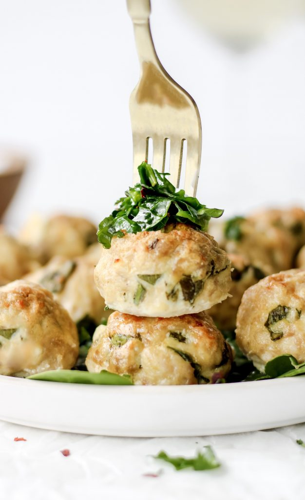healthy chicken meatballs stacked with a fork